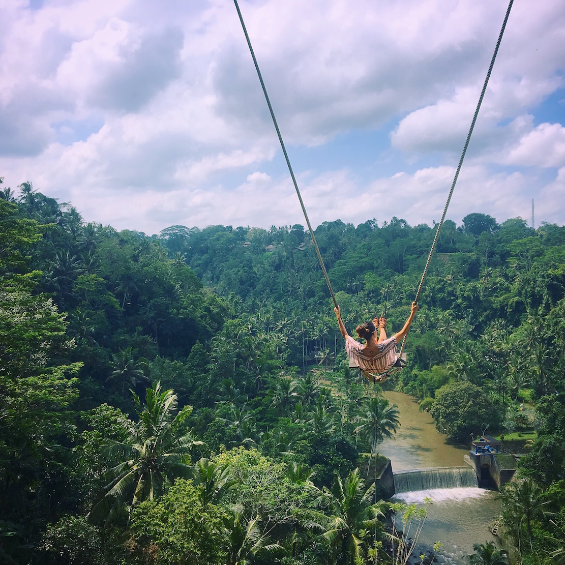 Zen Hideaway  Tucked away in the hills of Ubad and coated in dense jungle is a palm tree swing that allows you to soar over the falls below. The property also houses human-sized birds' nests with an unparalleled view.