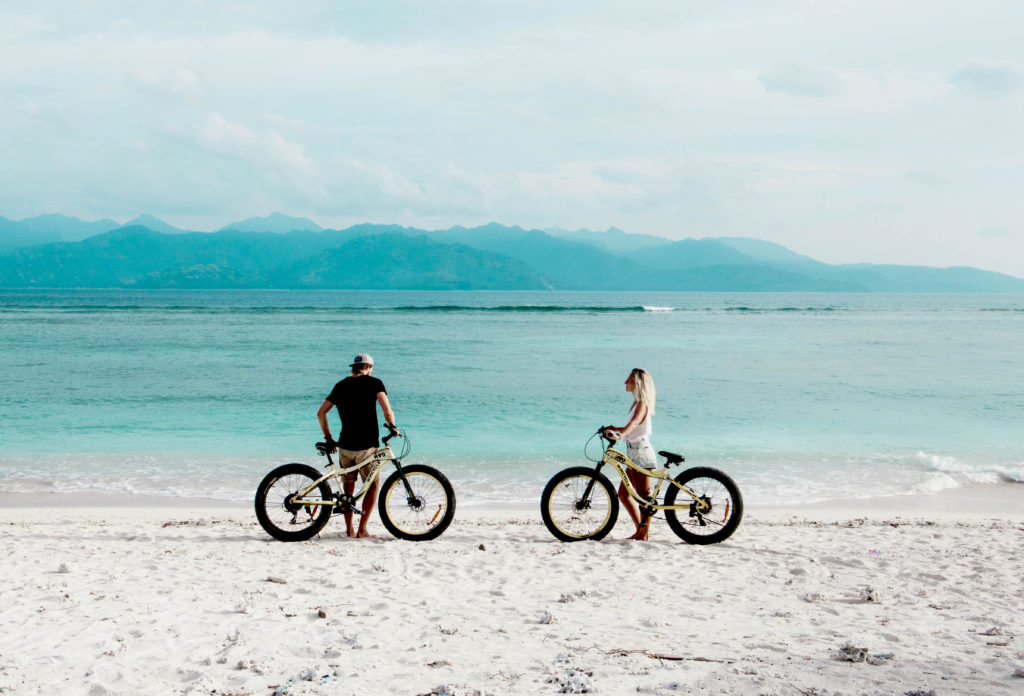 Bike Around the Coast  You'll discover beautiful beachfront lounge spots as well as floating swings and hammocks that hang above the most relaxing horizon you could ever imagine.   Gili Trawangan, Gili Indah, Pemenang, North Lombok Regency, West Nusa Tenggara, Indonesia  Photo courtesy of We Travel Asia
