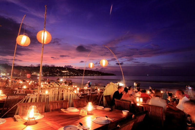 Menega Cafe  For the best seafood in Jimbaran Bay, go to Menega Cafe. Indonesians and tourists go there for a seafood feast while watching the sunset.   Jl. Four Seasons Muaya Beach, Jimbaran, Kuta Selatan, Jimbaran, Kuta Sel., Kabupaten Badung, Bali, Indonesia   www.menega.com   +62 361 705888