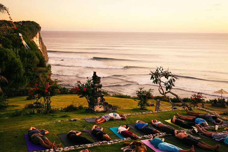 "Morning Light Yoga  ""This yoga shala is also surrounded by a sea of green jungle, but trumps Desa Seni's setting already gorgeous setting with its ocean views."" - Michelle Case     Jl. Pantai Suluban, Uluwatu, Pecatu, Kuta Selatan, Pecatu, Kuta Sel., Kabupaten Badung, Bali 80364, Indonesia  +62 817-555-365  Photo courtesy of Trip Canvas"