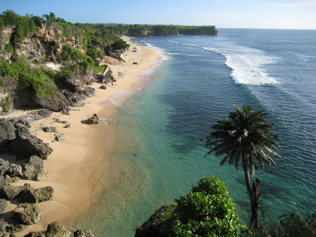 "Balangan Beach  This is a postcard-perfect white sand beach is lined with palm trees and cliffs and exactly what you picture when you hear, ""Bali."" - Michelle Case  Balangan Beach, South Kuta, Badung Regency, Bali, Indonesia"