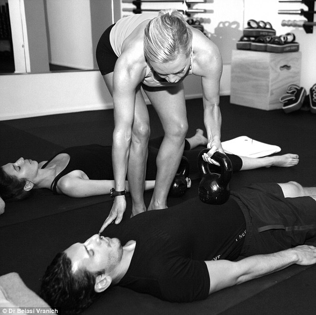 When we breath properly, Dr Belisa says (center), our shoulders should not rise and fall, as she demonstrates to a client. She is one of a growing number of trainers that see diaphragm breathing as the key to building strength and avoiding injury