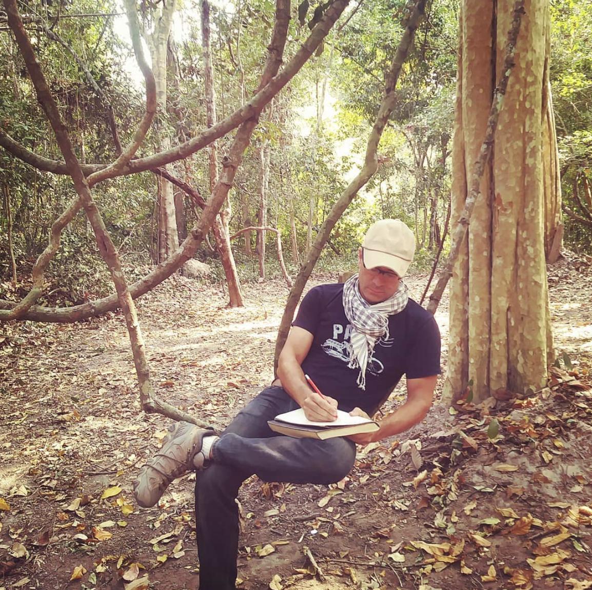 taking notes at Angkor.png