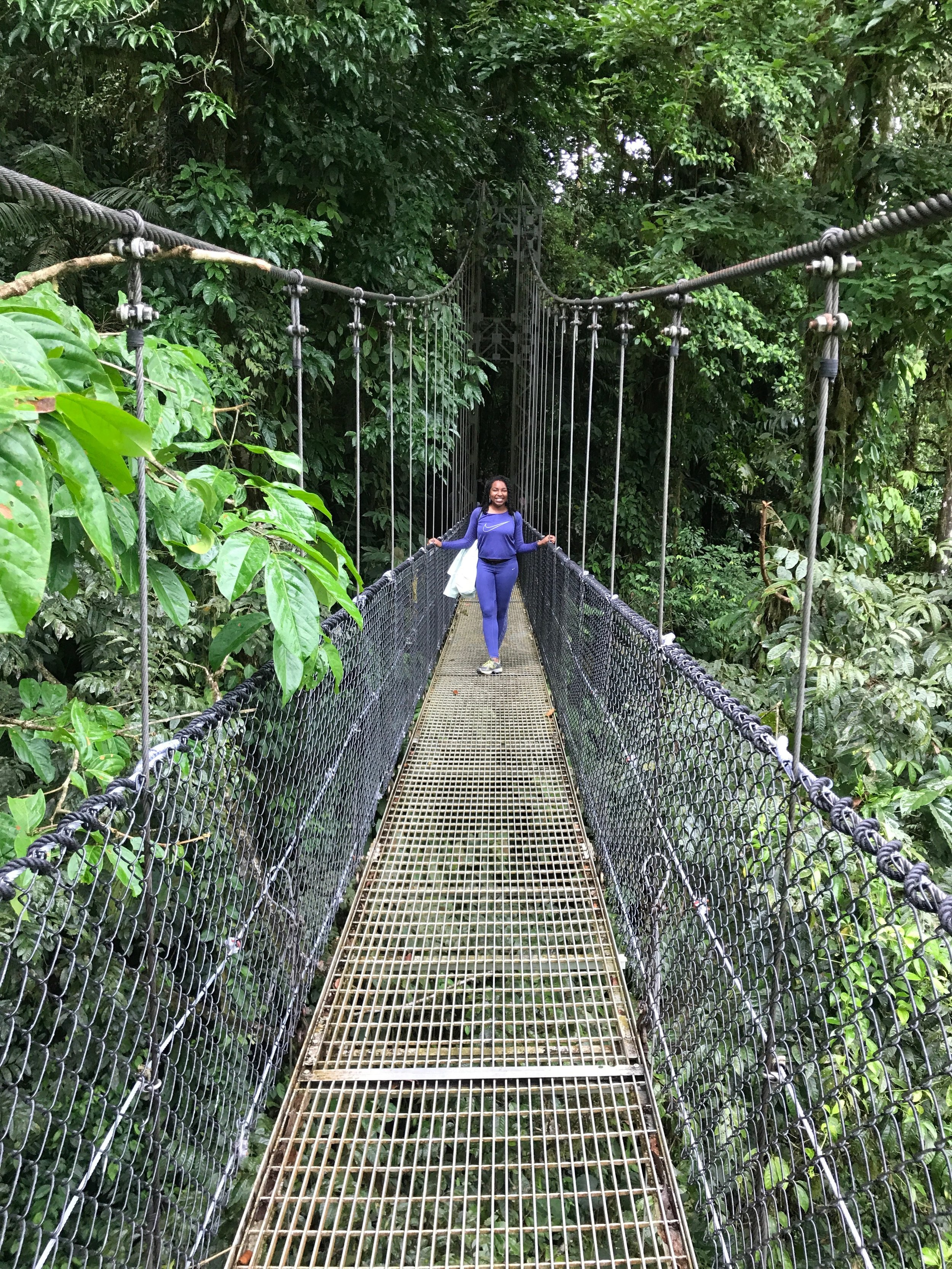 Crossing a hanging bridge more than 120 feet above the rainforest floor in the Arenal Volcano National Park in La Fortuna, Costa Rica. The views of the volcano and rainforest canopy were spectacular.