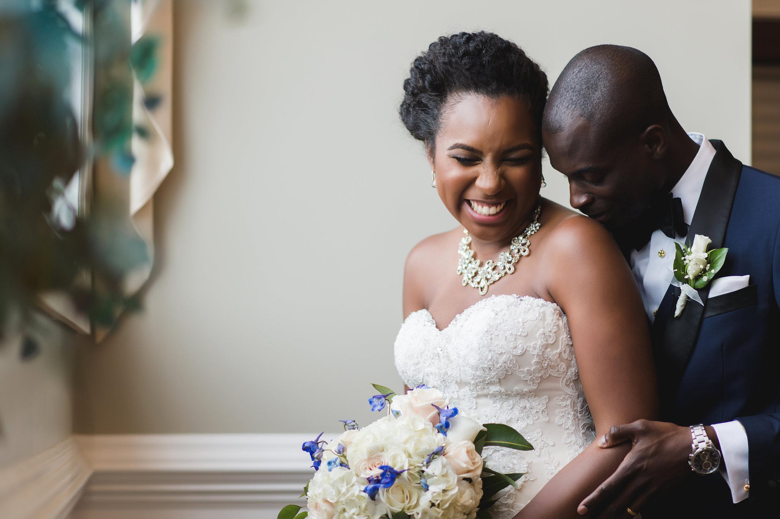 black-couple-laughing-wedding-day