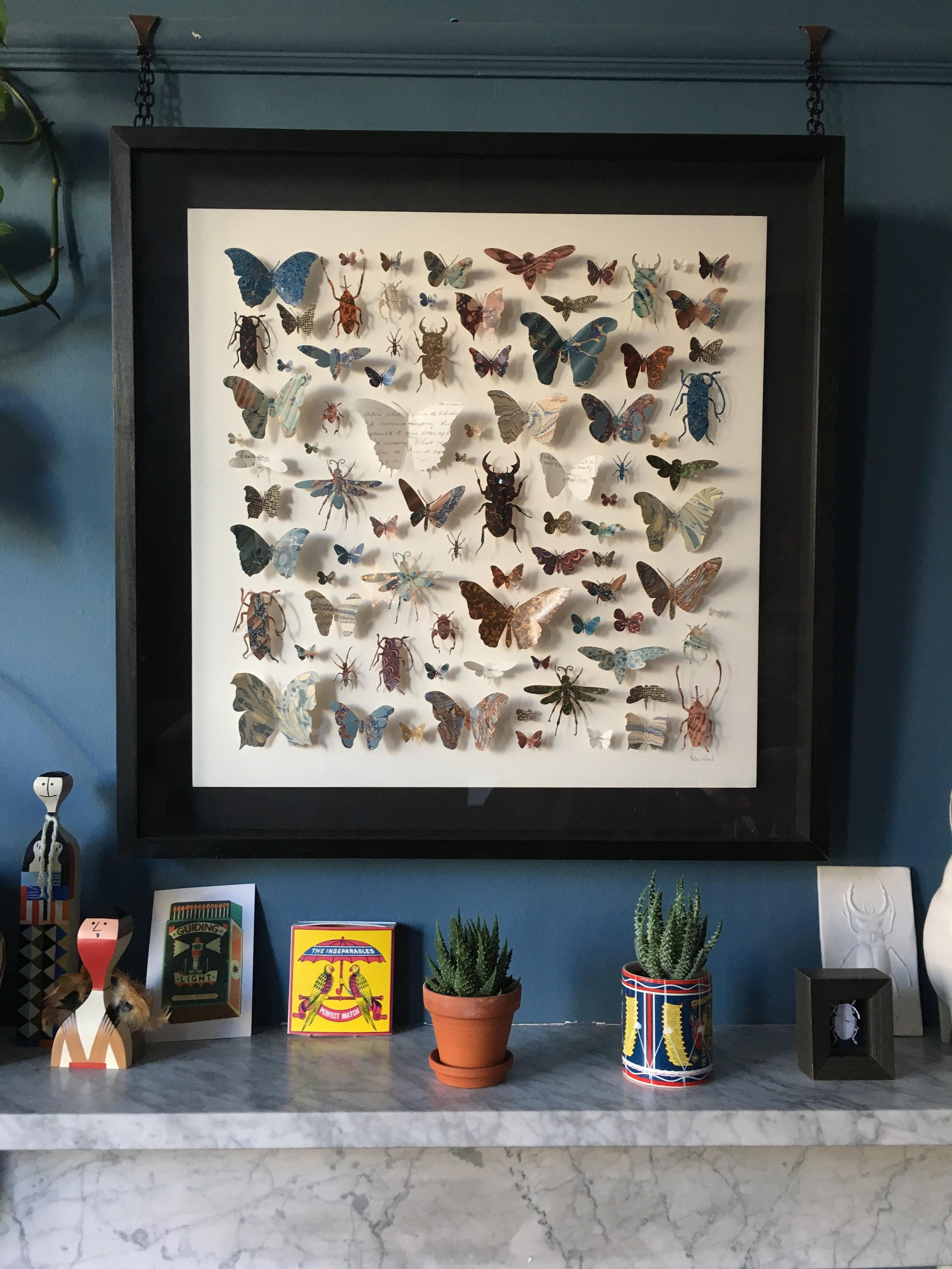 One of Helen's paper entimology pieces up in her living room