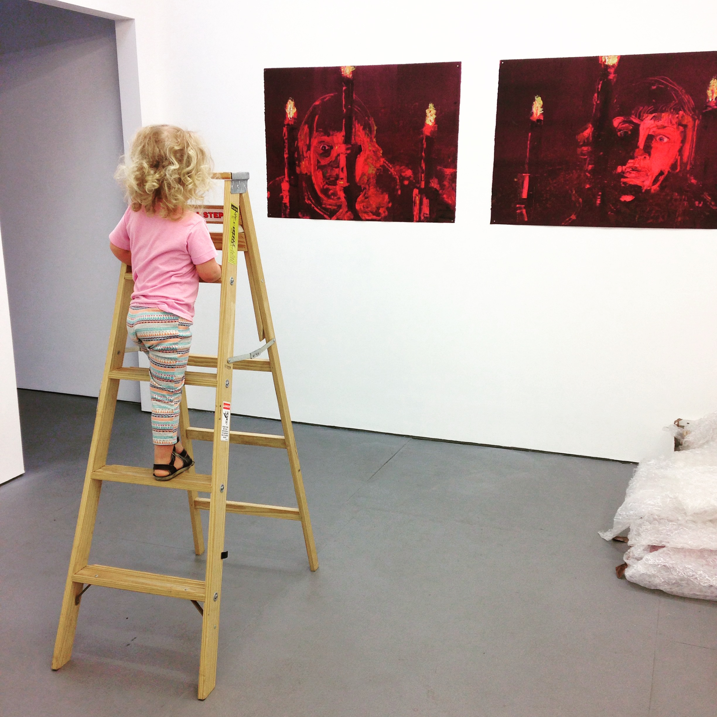 "Hoving + Paris' daughter assisting installation of Night Flight, TSA New York (2015); Featured work: Angela Dufresne, ""Ivan the Terrible Series"""