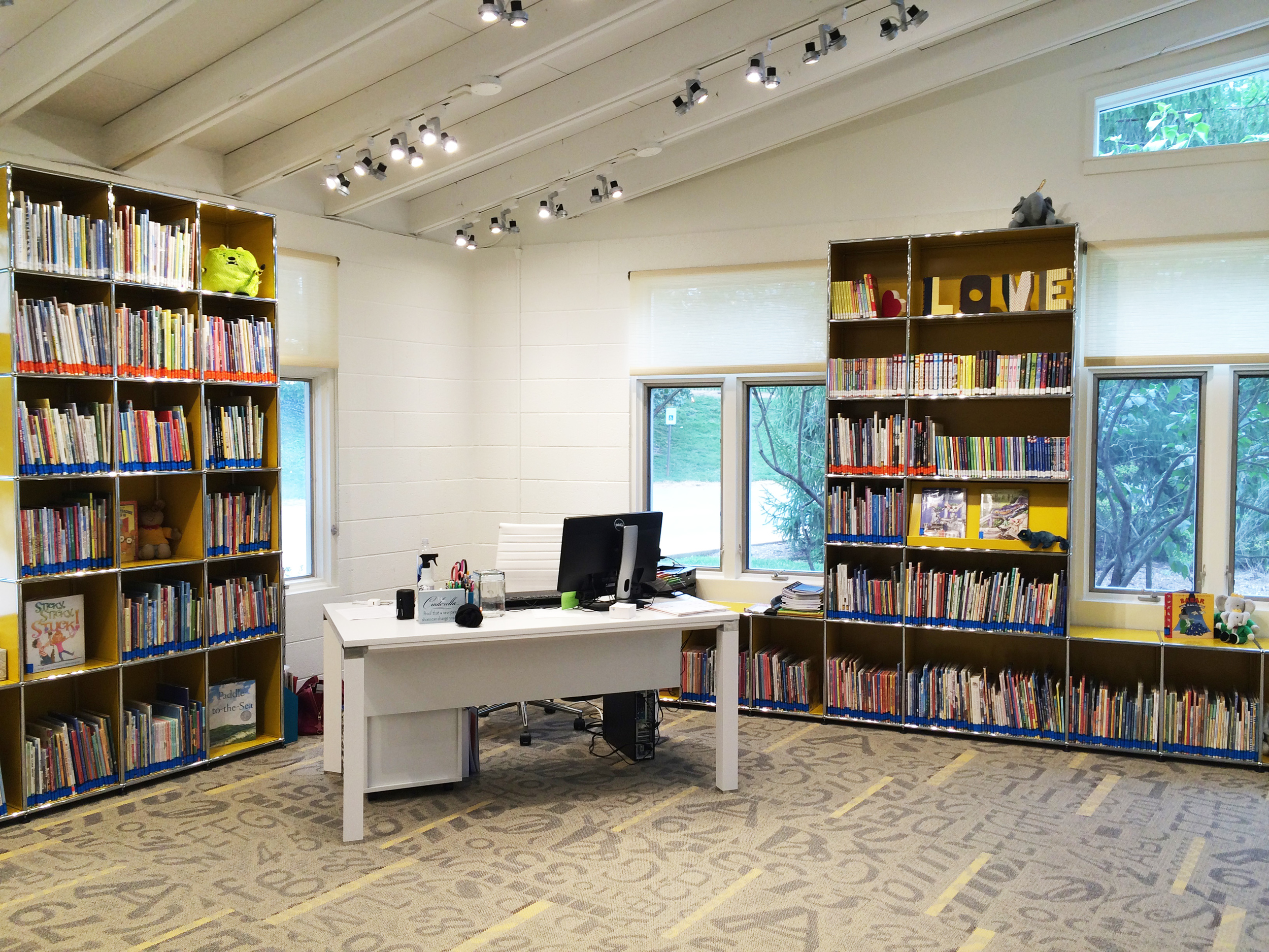 Custom shelving from USM, warm lighting from WAC, and Danish furniture from Jesper Office make the library a favorite spot for students and teachers, alike.