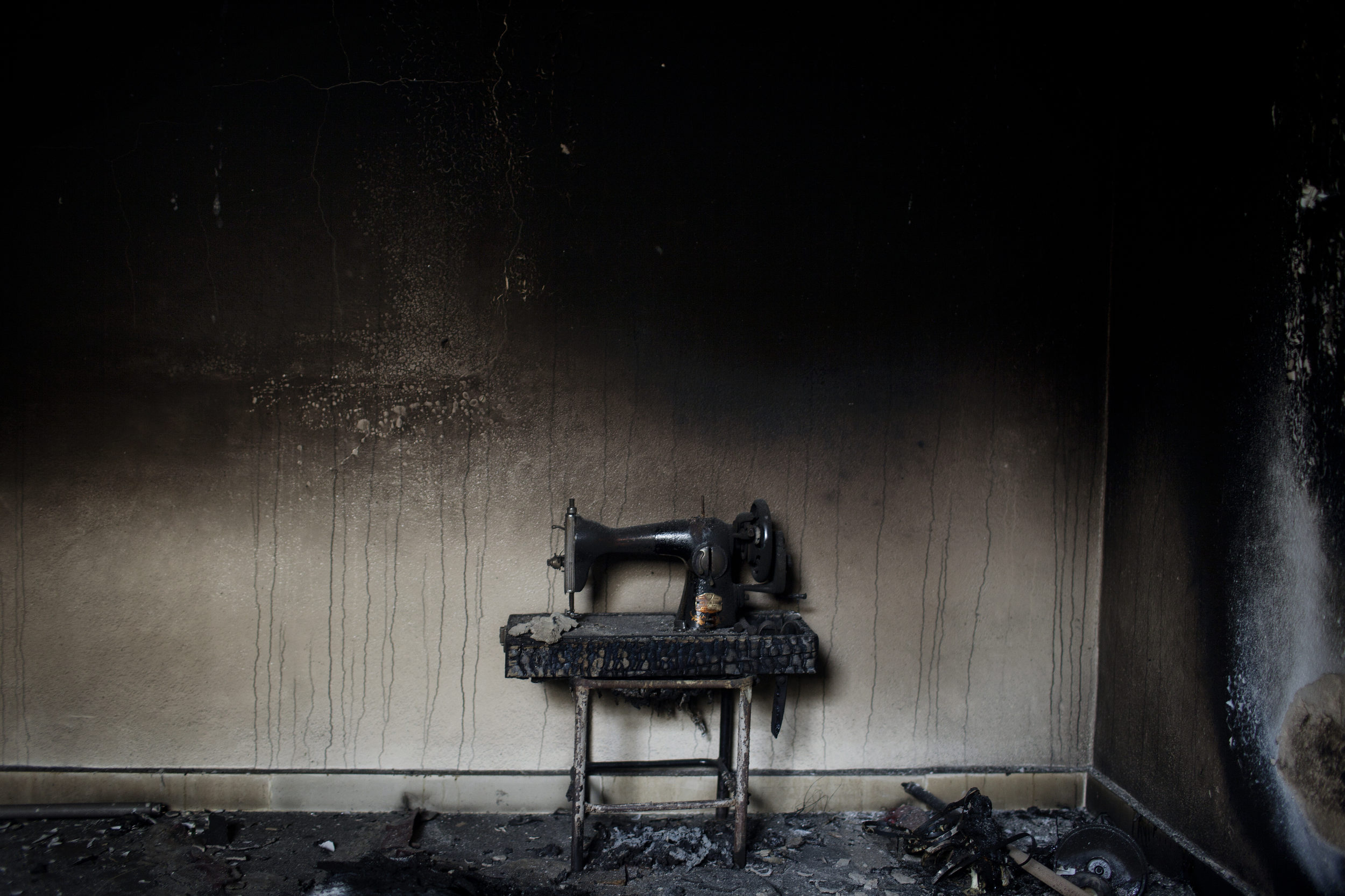 Sewing machine in a home destroyed by the regime, Kili.