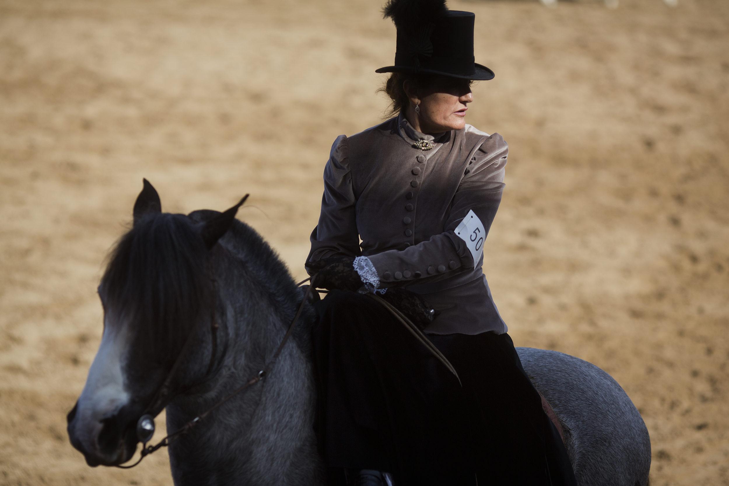 Side saddle.