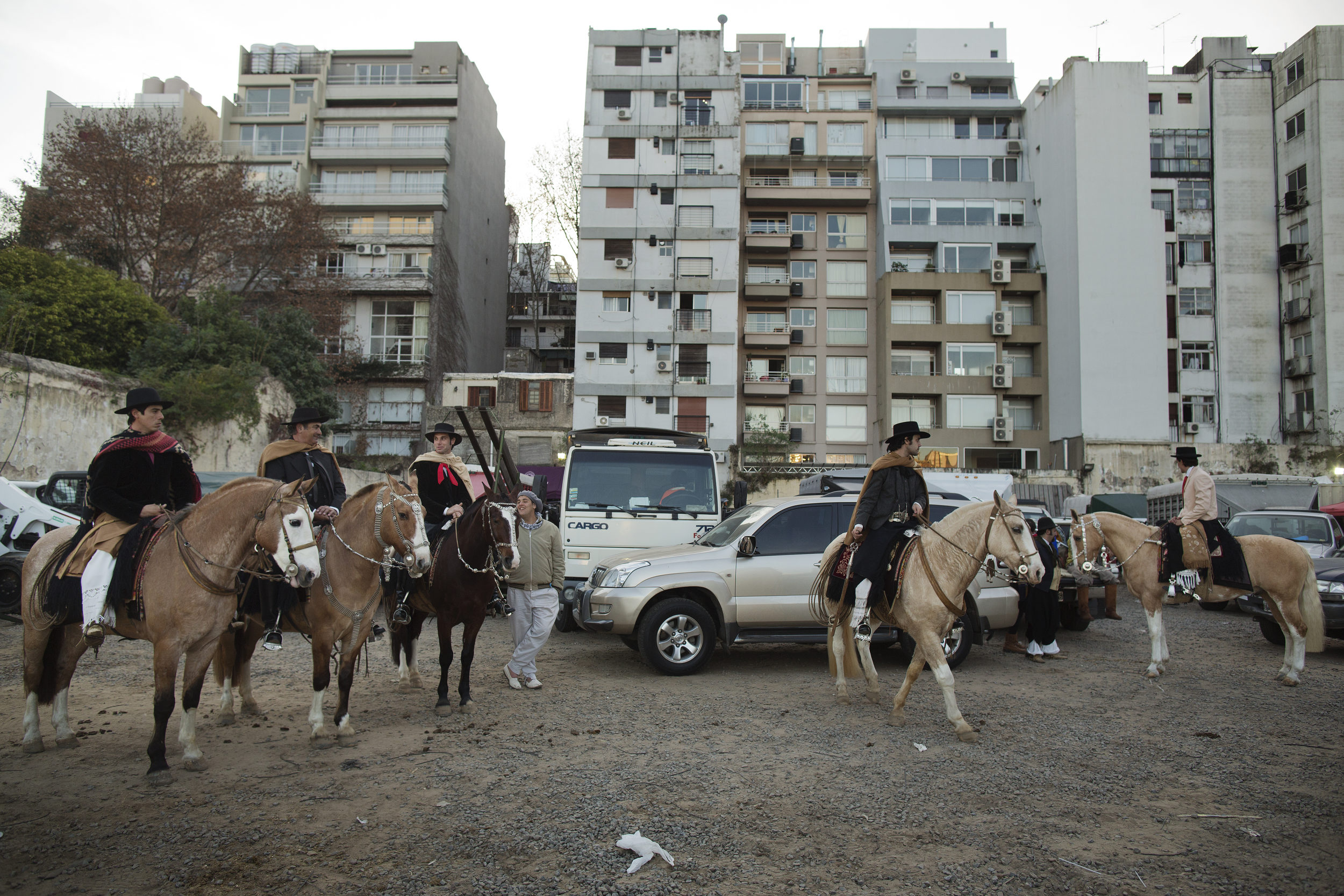Pablo and a team of riders prepare to enter the ring in a suburb behind the Rural.