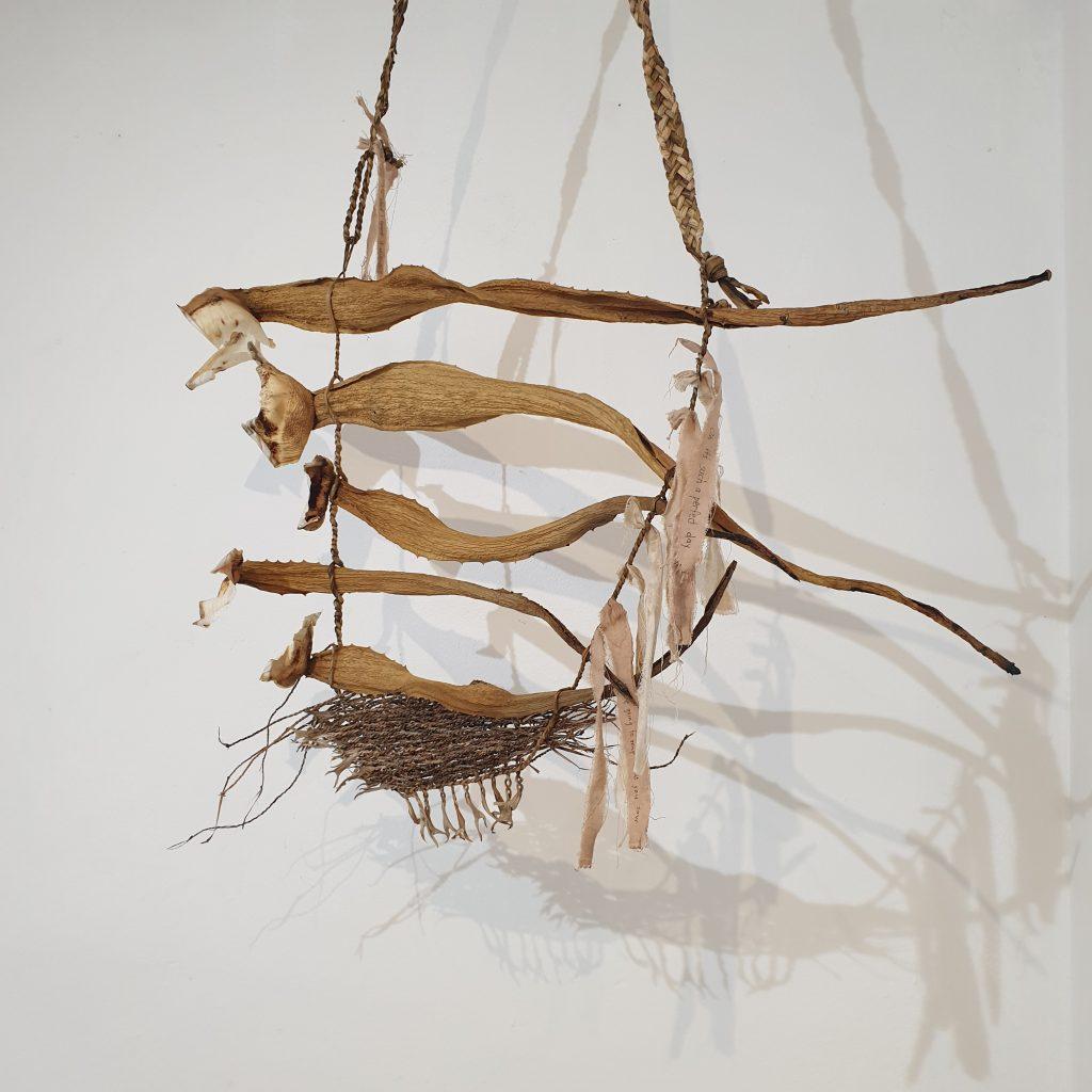'Anthropocene - nature's millstone - Woven wall piece' Fibres: agave, dracaena marginata, iris, eucalyptus-dyed calico strips Techniques: braiding, string-making, weaving/ twill, eco-dyeing Dimensions: 100 x 80 cm $240