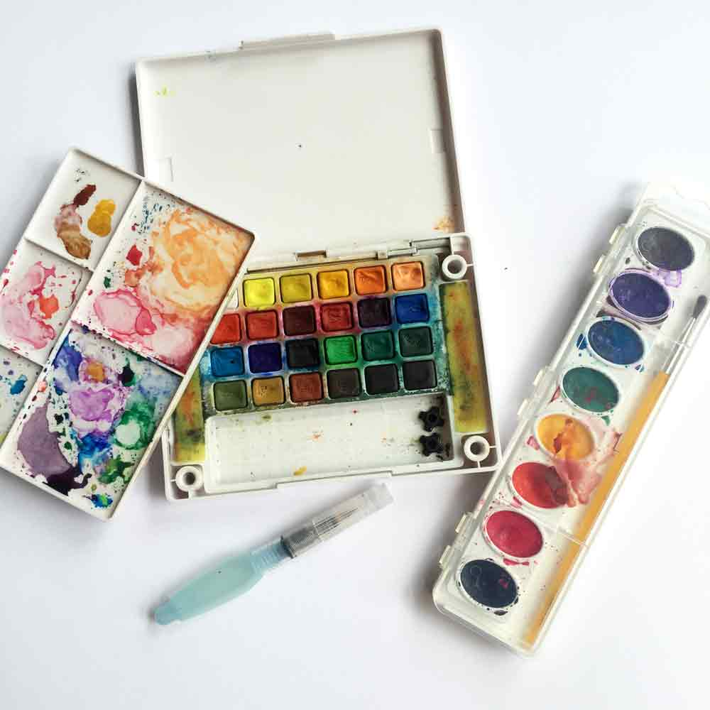 These are my no pressure watercolour supplies. Cheap and cheerful pan sets that - as you can see - get used a lot! My go-to favourite is my Sakura Koi travel set shown on the left, and the little Crayola set I mentioned is pictured on the right.