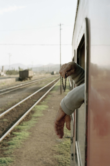 Photography:  Ian Berry,  Prayer Beads on the Ankara  train