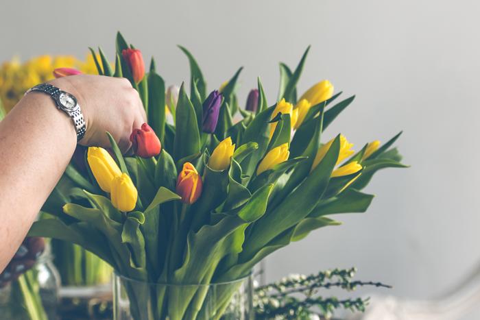 Woman arranging Tulips.