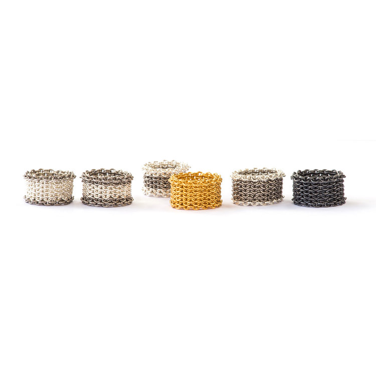Basket Rings  [left to right]  Silver with titanium edges  Silver with titanium bands  Titanium with silver bands  22 carat gold vermeil  Titanium with silver edges  Oxidised silver