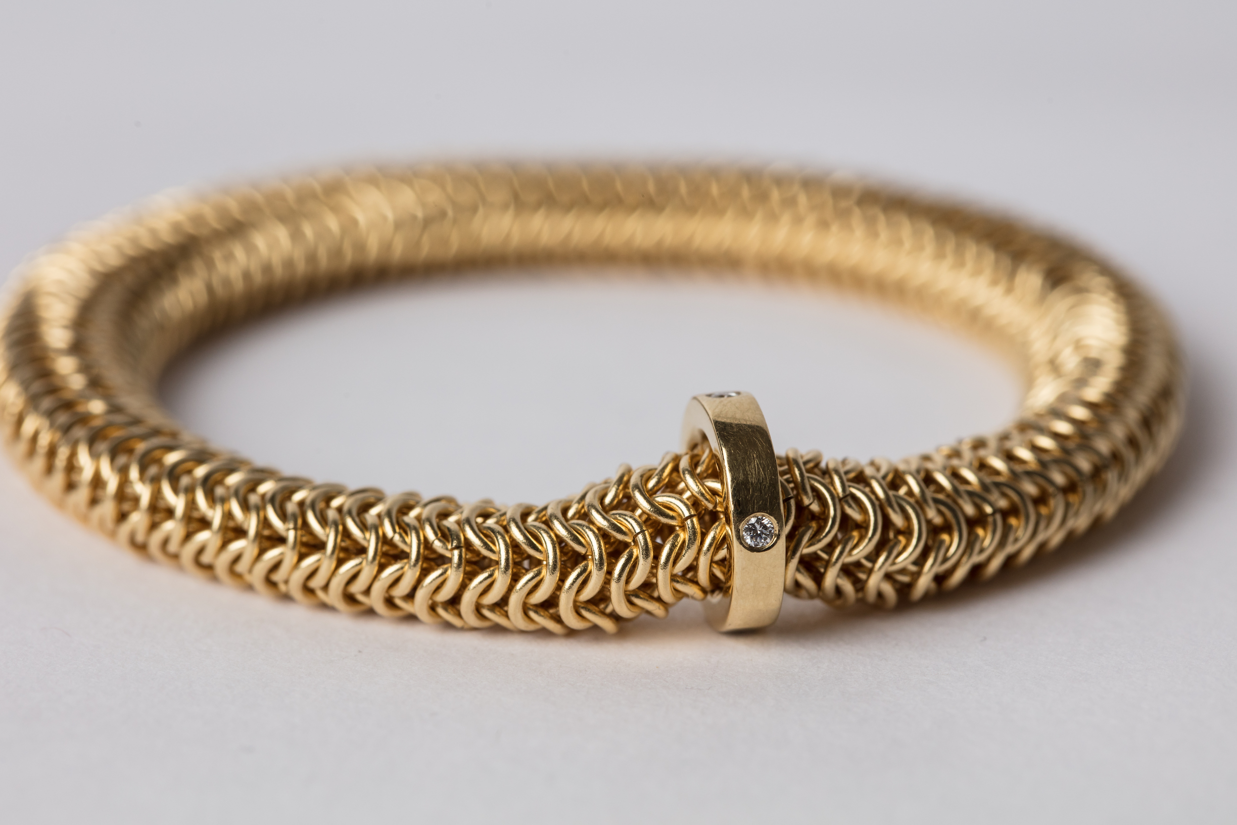 18ct Gold Tube Bracelet with 18ct Gold and Diamond Runner