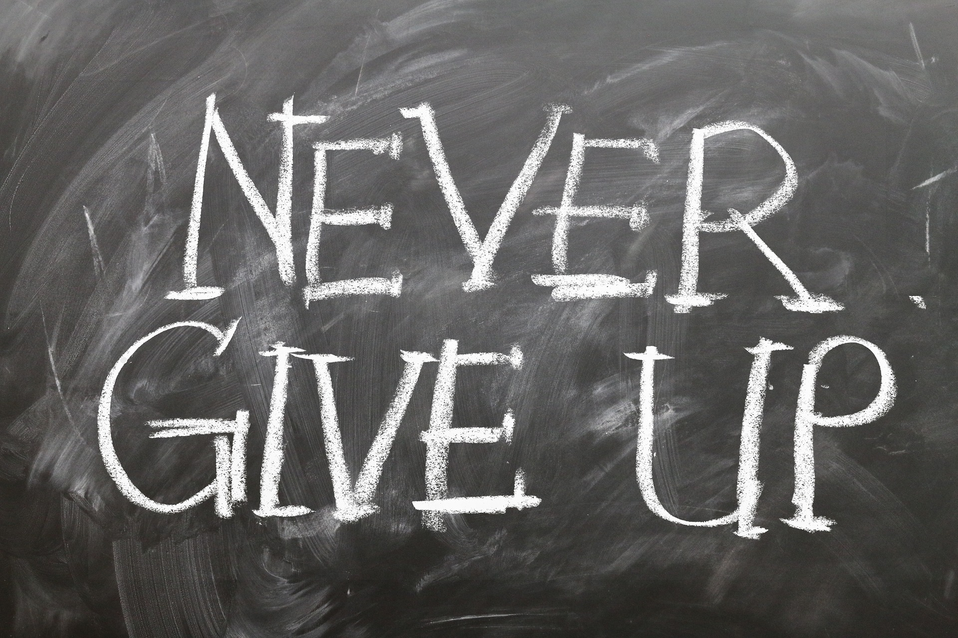 Never Give up on black board.jpg