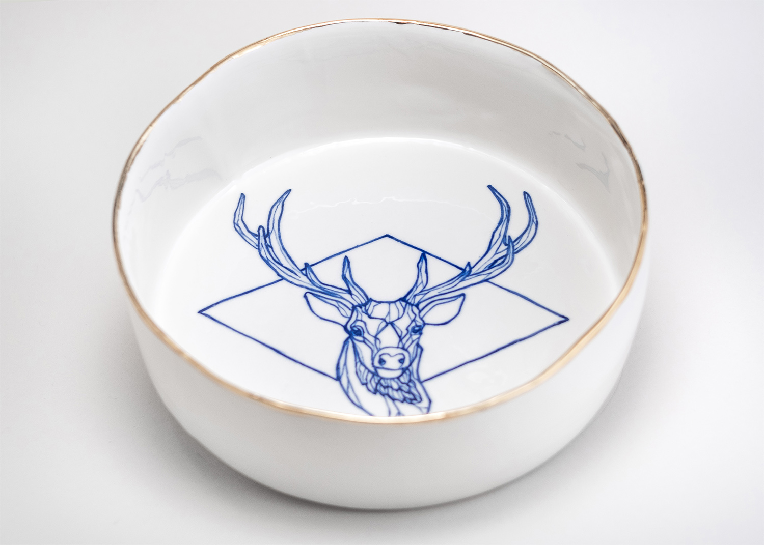 Porcelain painted bowl deer tattoo handmade ceramic berlin antikapratika tattooed porcelain.jpg