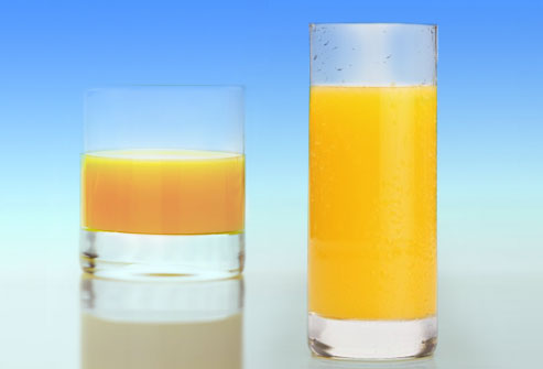 Figure 1: We will tend to, on average pour more juice into the wider glass than the tall one, even though the two glasses hold the same capacity.