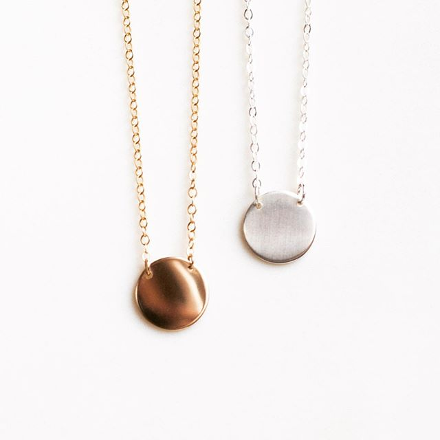 Creamy dreamy disc pendants 😍 Would you pick gold or silver?