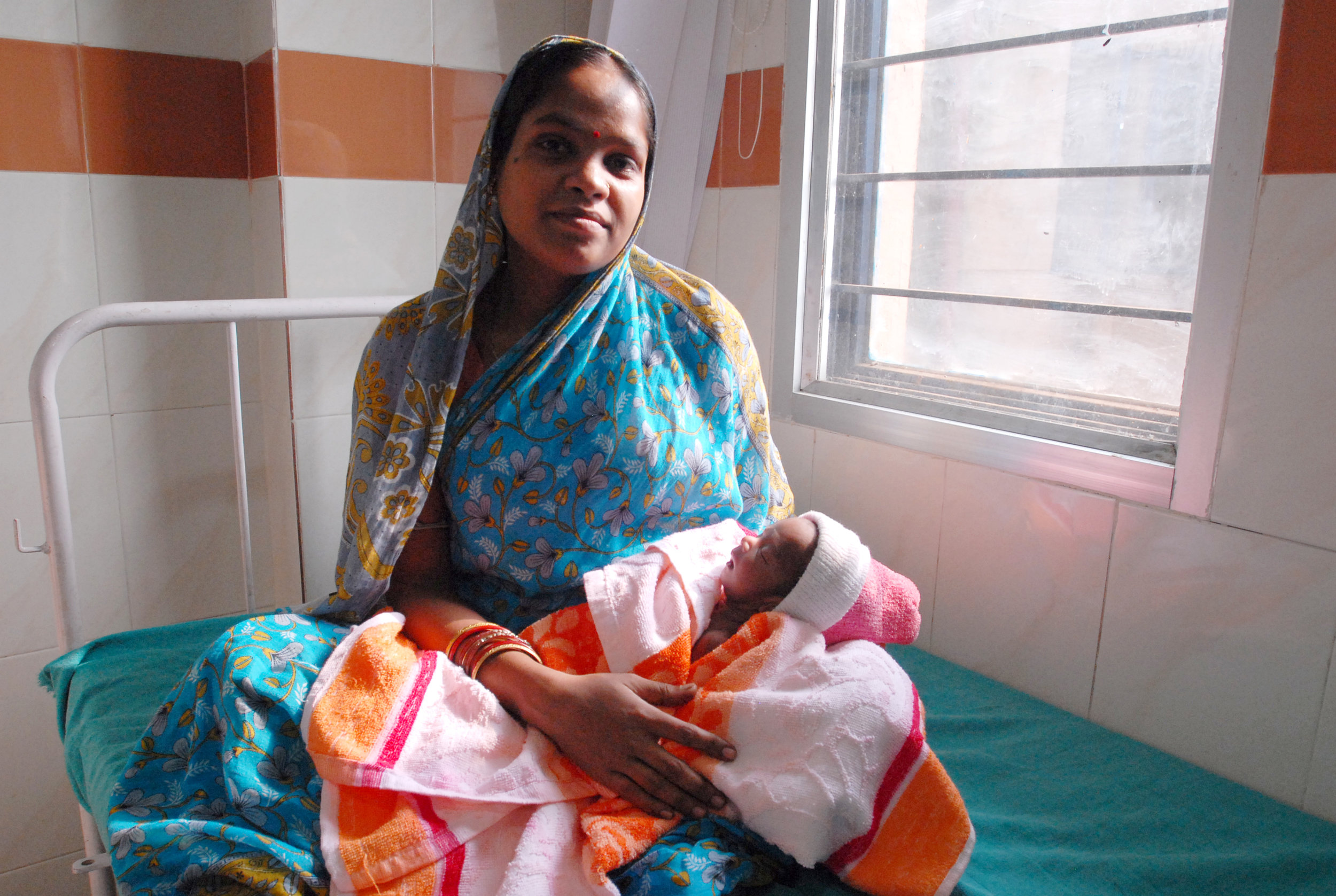 Mother_and_newborn_child_in_Orissa.jpg