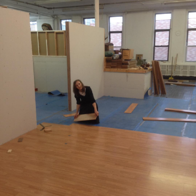 Laying down the laminate floorboards in the new space