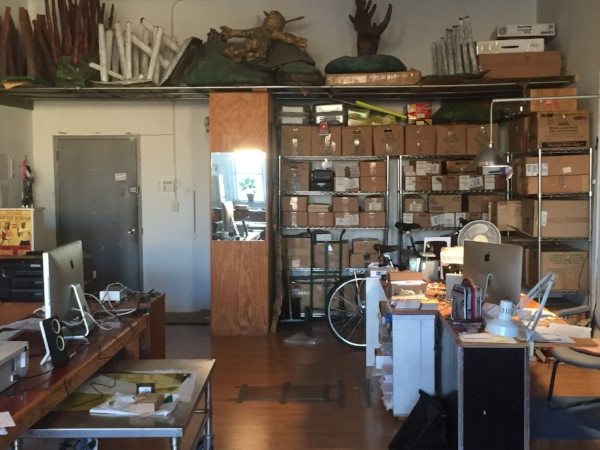 Studio workspace area with storage space near entrance