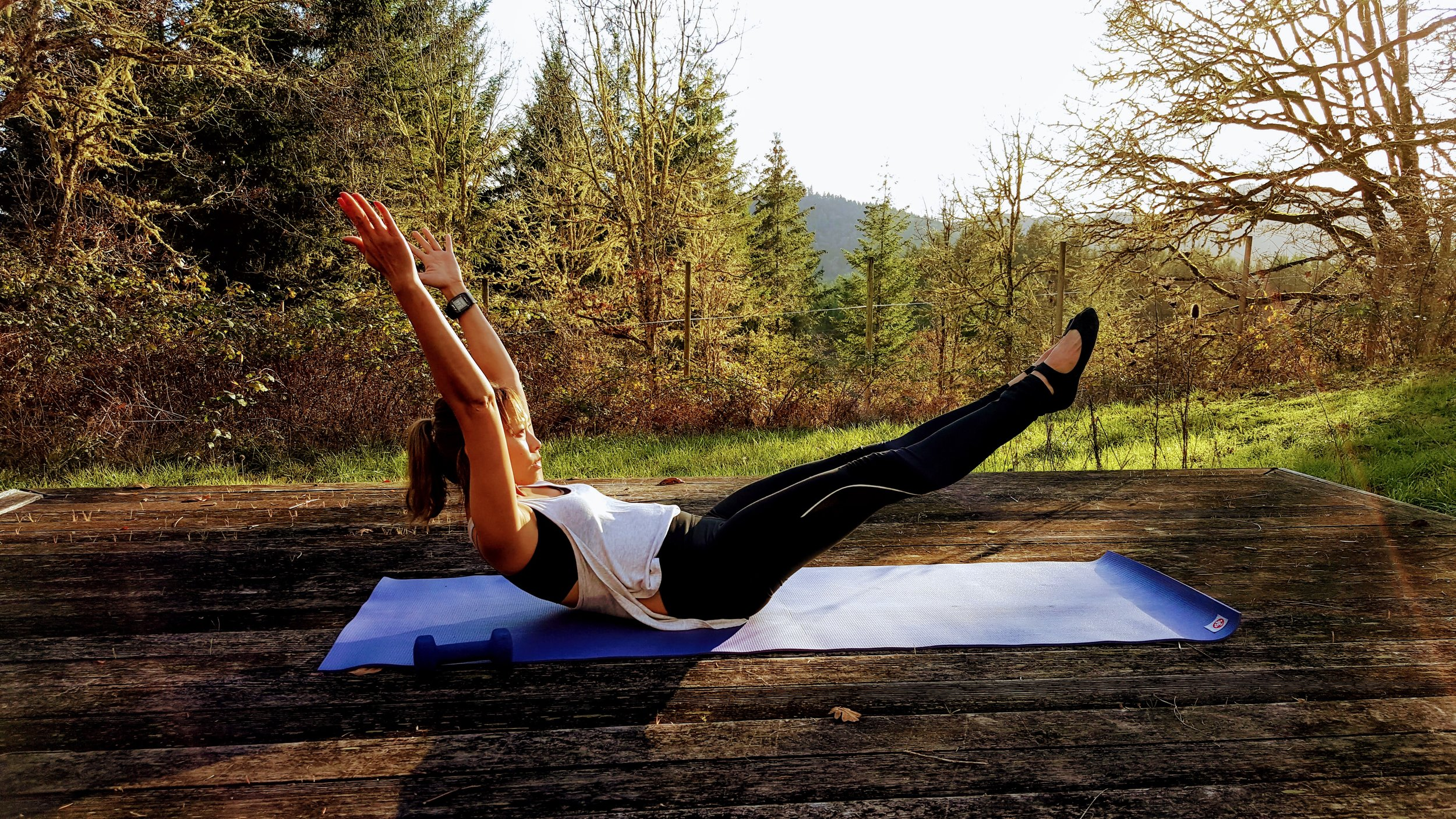 6.    Begin with legs in table top, curl up head neck and shoulders as you exhale, reach palm of the hands towards your knees. As you inhale, reach arms straight over your head and reach legs out to your high diagonal. Imagine as if you are being pulled in two different directions as you lengthen. Do 8-10