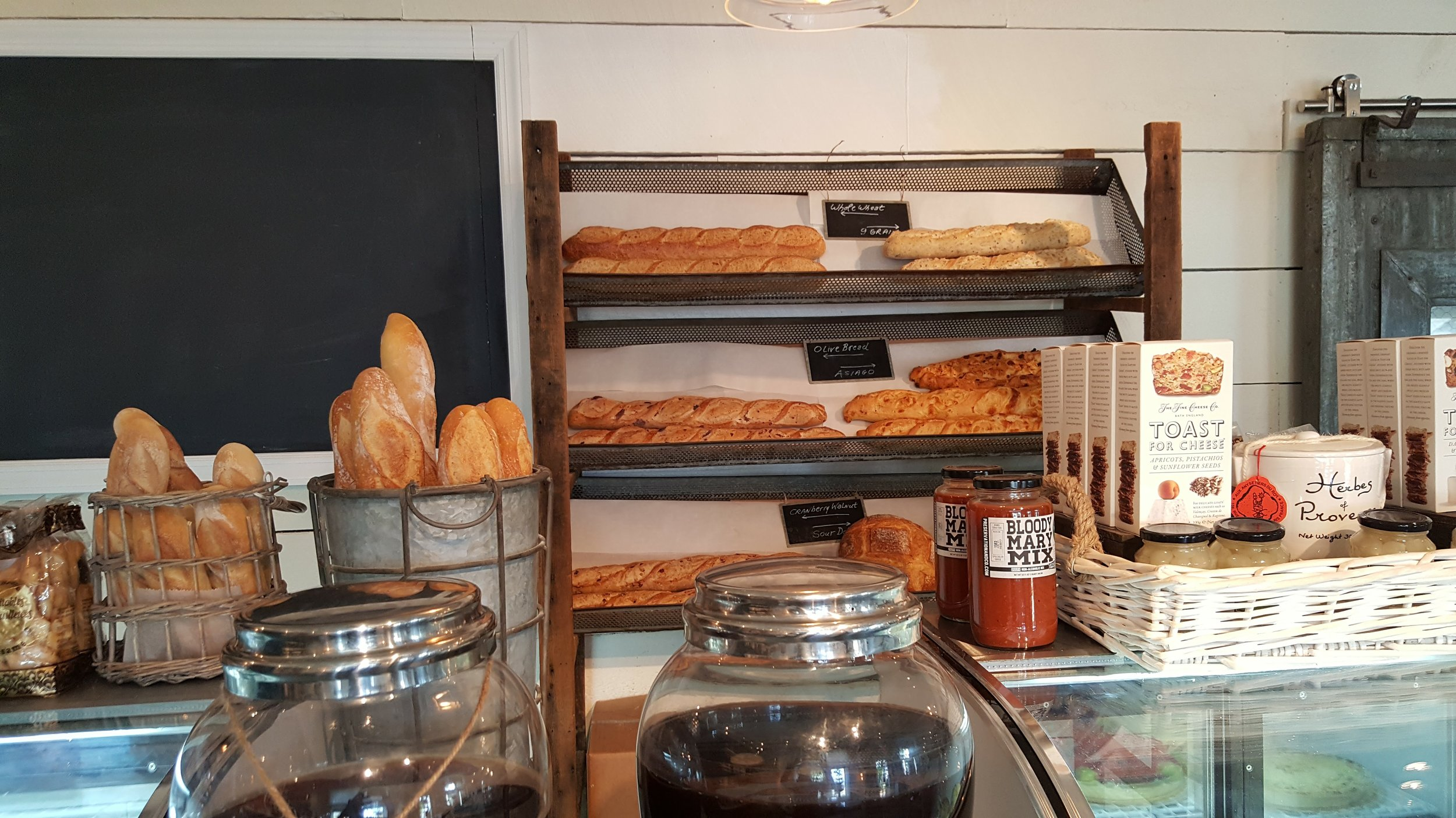 Fresh baked breads line the counters