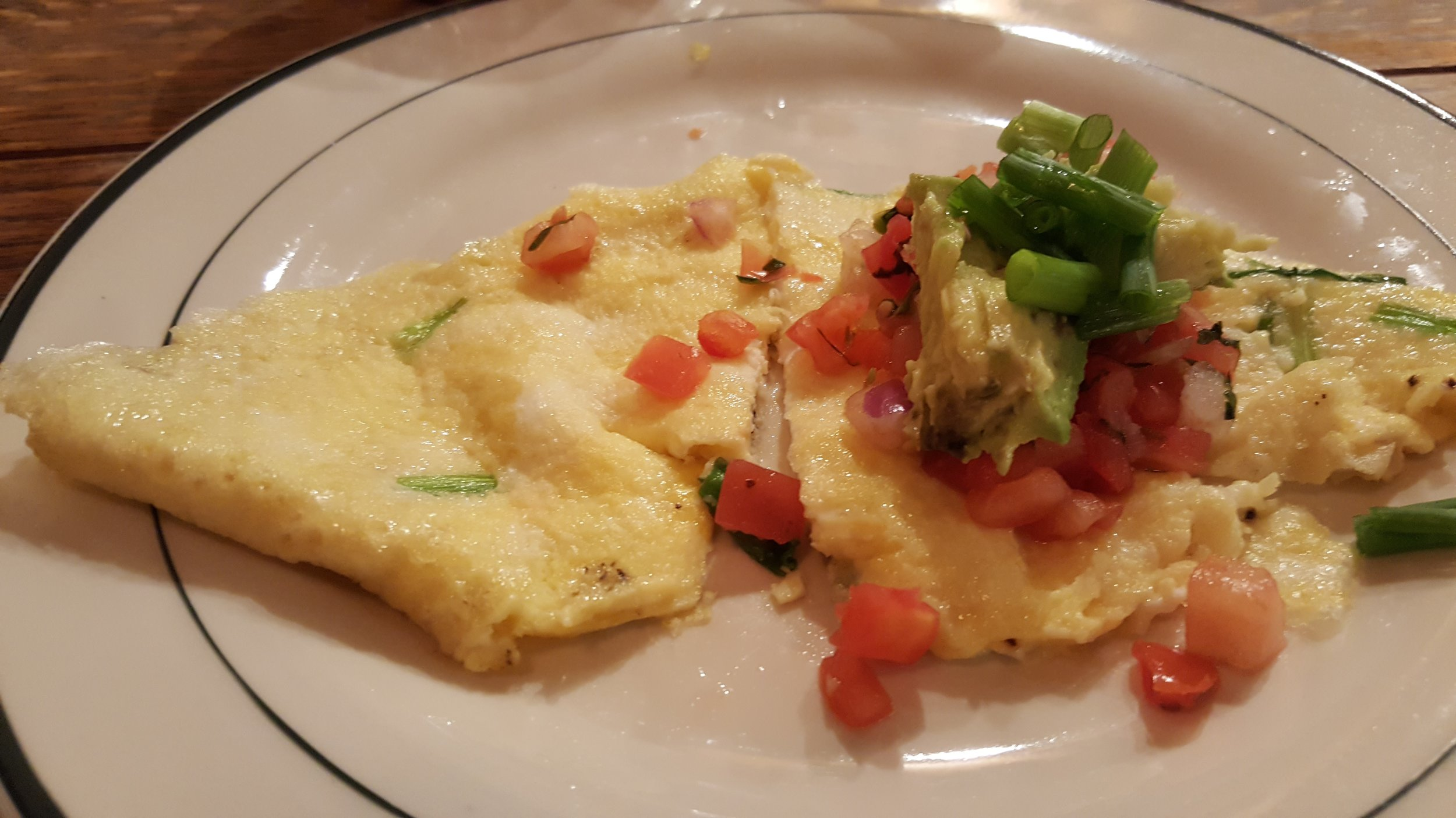 "Egg omelette ""burrito"" with salsa"
