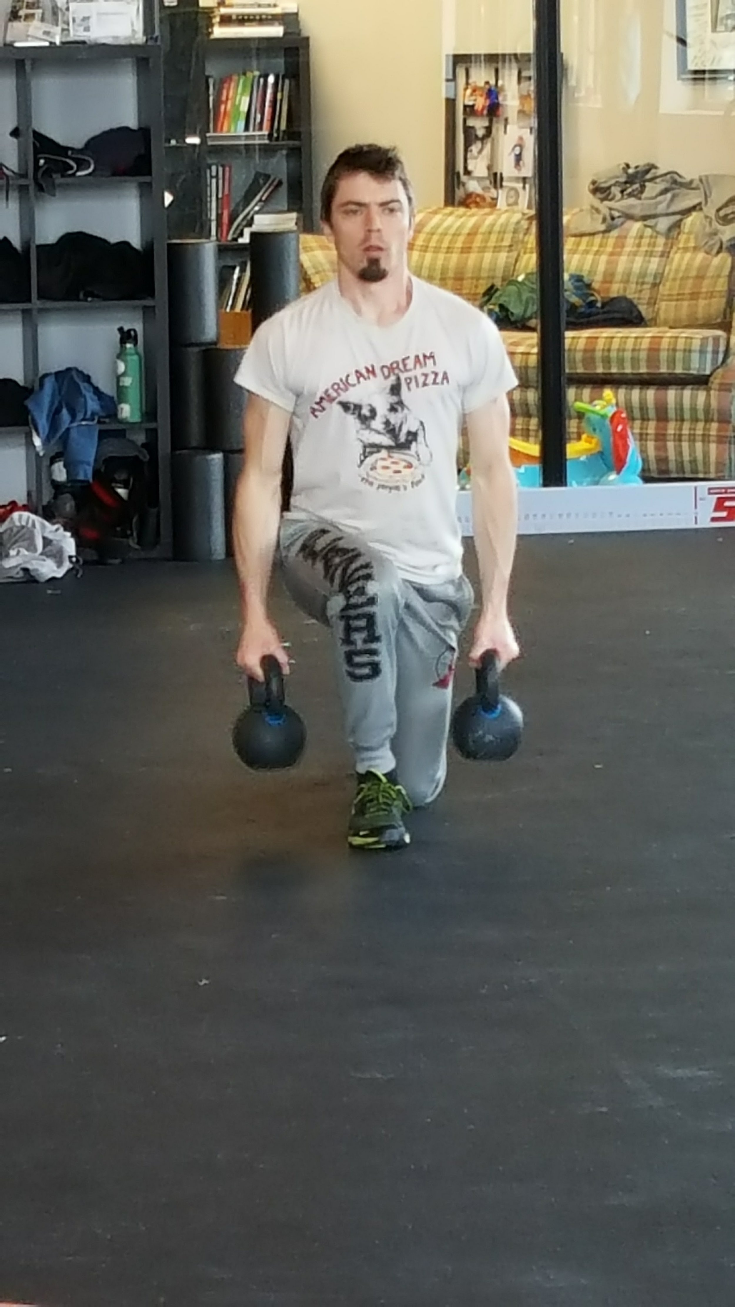 Athletes train with kettlebells to build strength