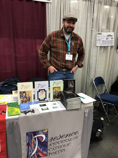 Ryan Wilson during his book signing for  The Stranger World  (Measure, 2017)