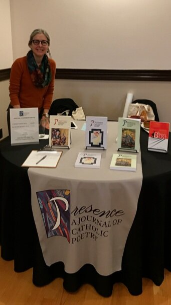 Founding editor, Mary Ann B. Miller, staffs a table at the 13th Annual Indie Lit Festival, Frostburg State University, Frostburg, Maryland.
