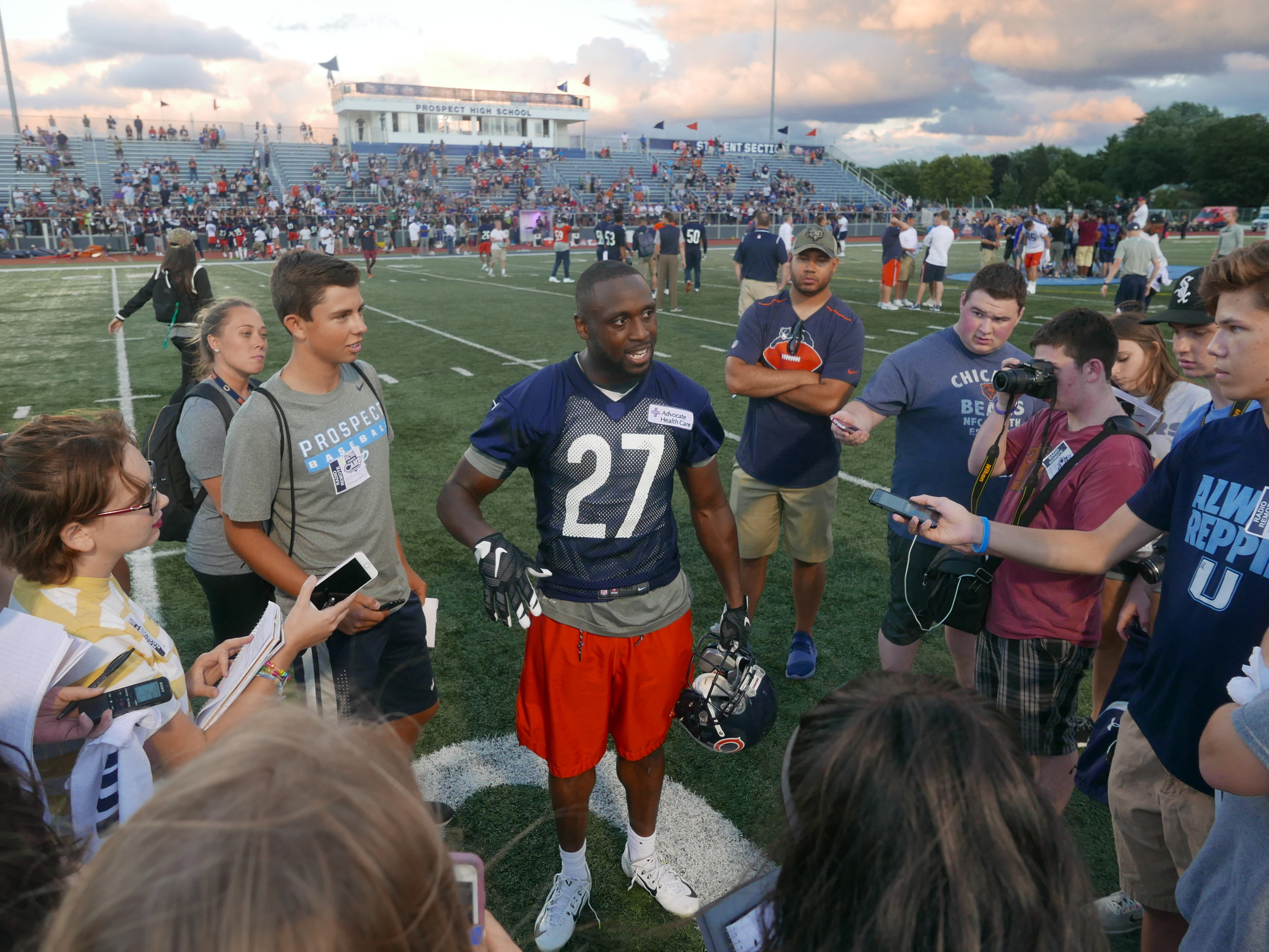 Student journalists from across District 214 gained press credentials to cover a Chicago Bears practice in August 2017 at Prospect High School. The students interviewed Sherrick McManis of the Bears following the practice.