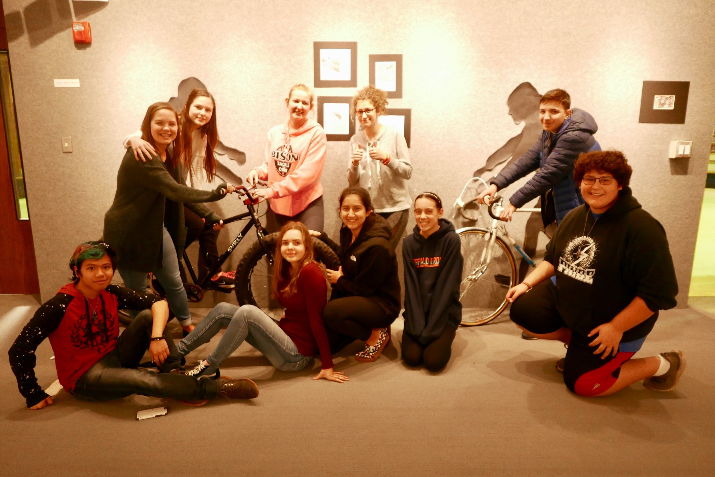 members of the one grove gallery in the student-run space. the gallery provides real world learning experiences for students.
