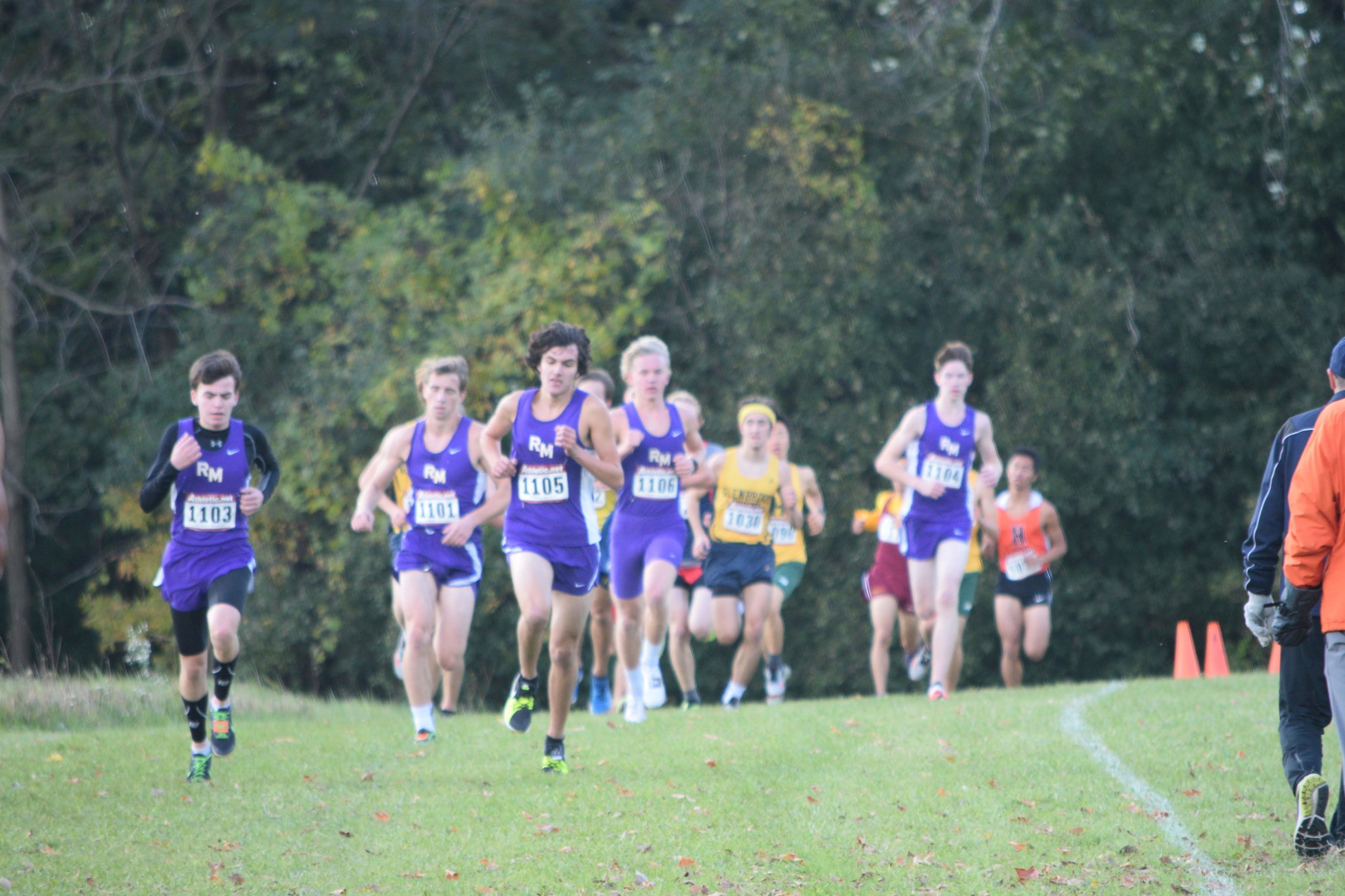 Members of the Rolling Meadows boys cross country team run during a meet leading to the state competition.
