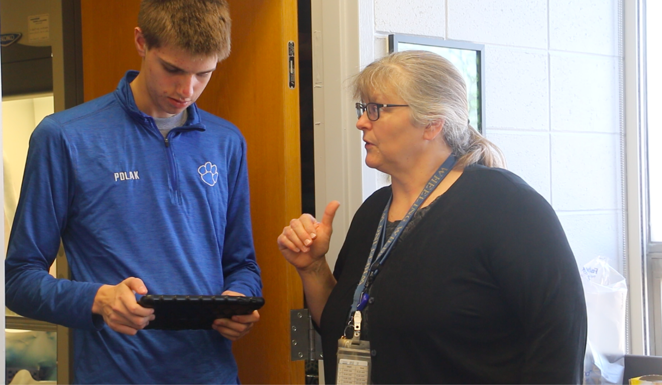 Carol Bouvier works with a Wheeling High School student. Bouvier signed up her students for District 214's Mentor Matching Engine platform, giving the students the opportunity to connect with industry professionals to explore careers and get feedback on their work.