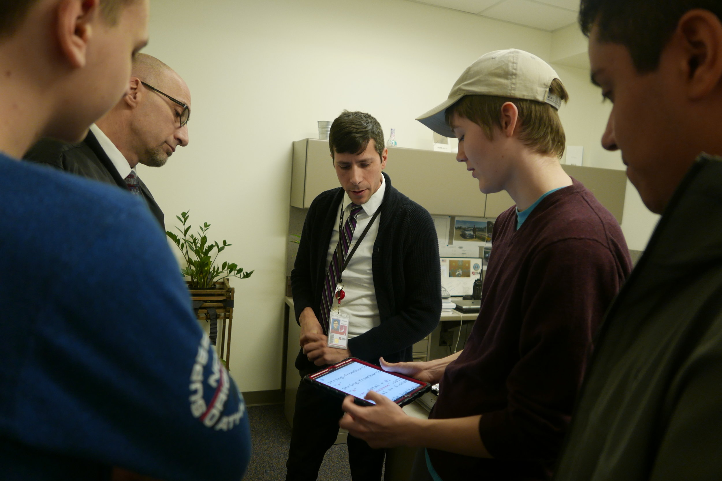 District 214 students work with the District's IT Department as part of their cybersecurity apprenticeships.