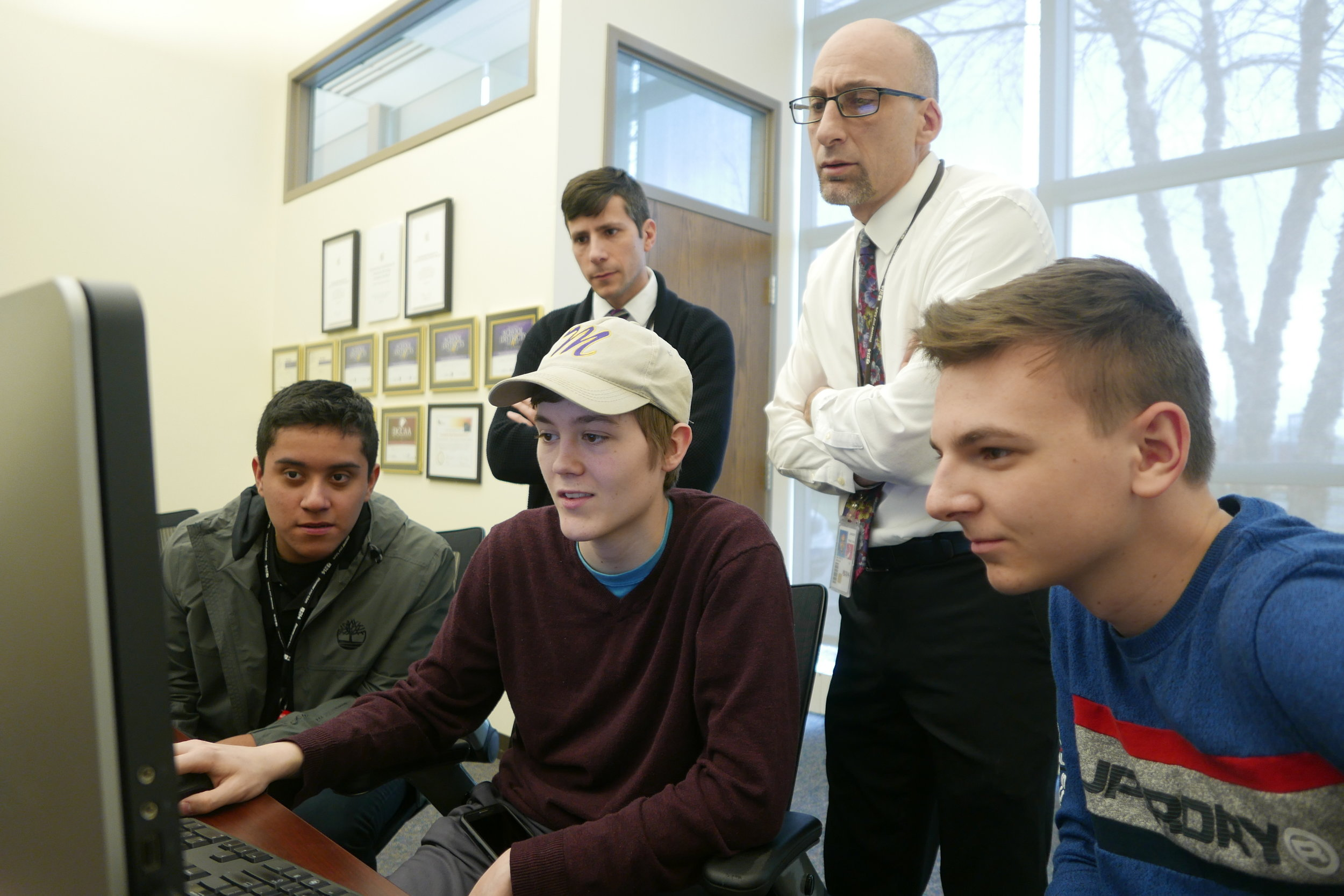 District 214 students (from left to right) Jovany Melchor, Bob Voss, Edin Hodzic are cybersecurity apprentices in the District's new Youth Apprenticeship program.