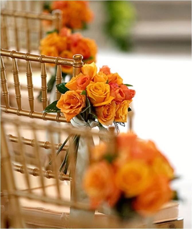 Orange rose pew ends.jpg