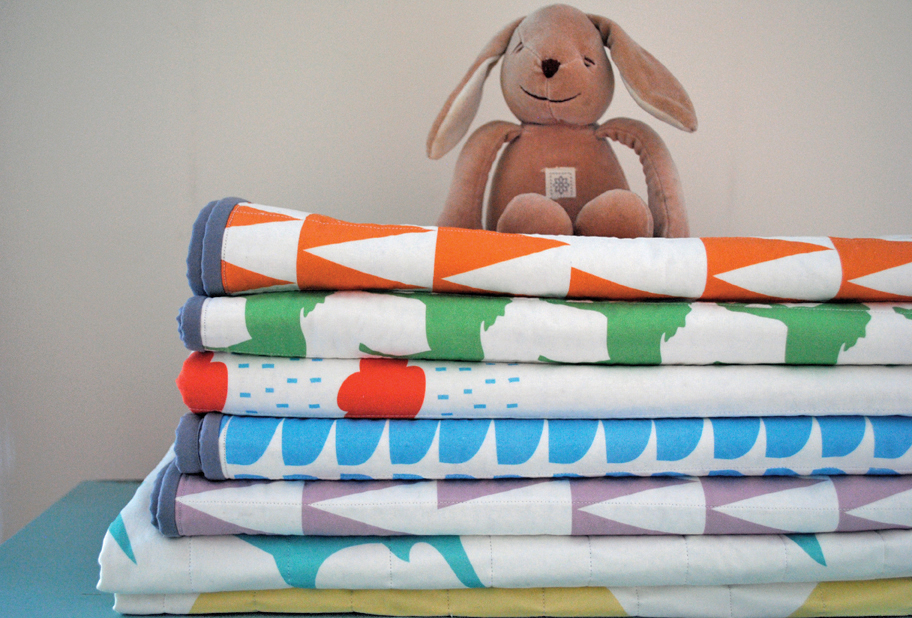 Colorful baby quilts.