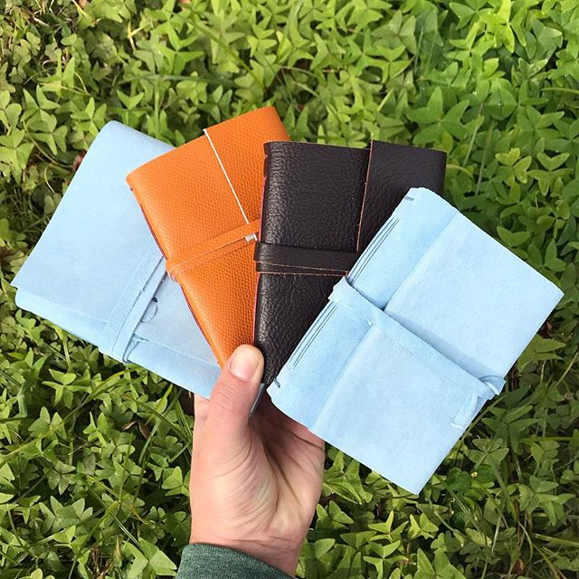 I have a few leather bound journals left after the markets. Three of the larger size in blue suede with handmade Khadi paper inside with a beautiful natural deckle edge running across the top of each page. The smaller ones have several endpaper options with English Somerset paper inside! Both papers are very thick and great for painting/illustration/vigorous writing. $35/$25 stop by the studio or message me and I'll ship one to you. #handbound #smallfirespress