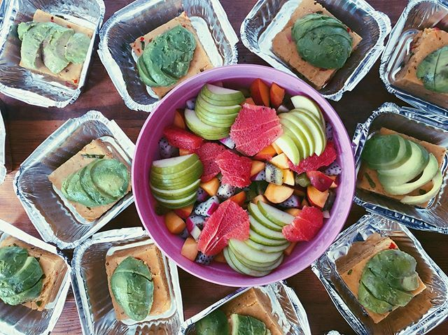 Breakfast delivery. Vegan jalapeño cornbread with lime avocado fans and tropical fruits! 🥥🍈🥭🍉🍇🍒🍊