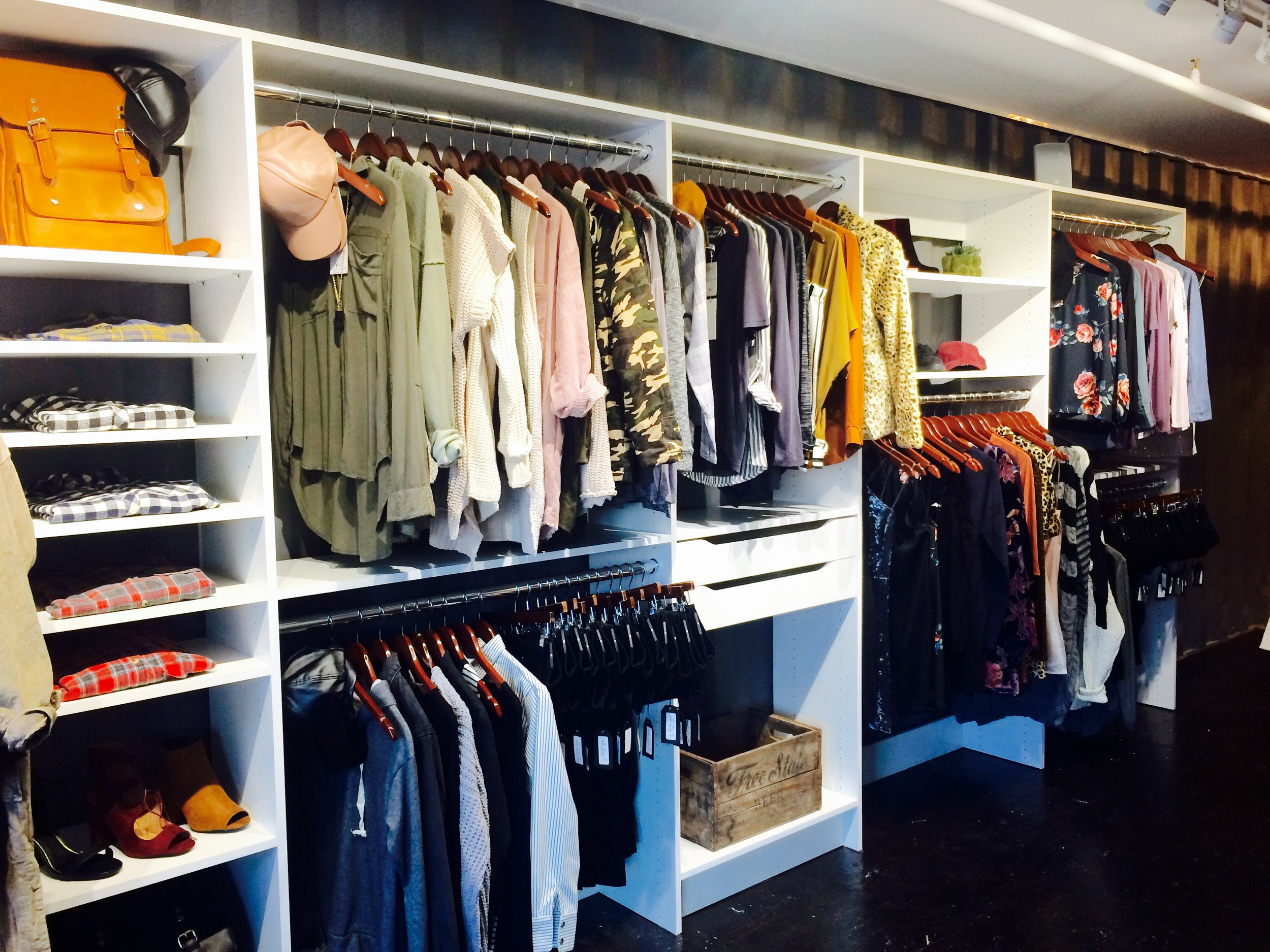 Custom closet shelving for shoes, purses, clothes and accessories makes this boutique feel like a high-end closet. Located at  Beau&Arrow in The Boxyard Tulsa , this closet system is built into side-by-side shipping containers.  Call Closets of Tulsa today to see what's possible in your space:  918.609.0214