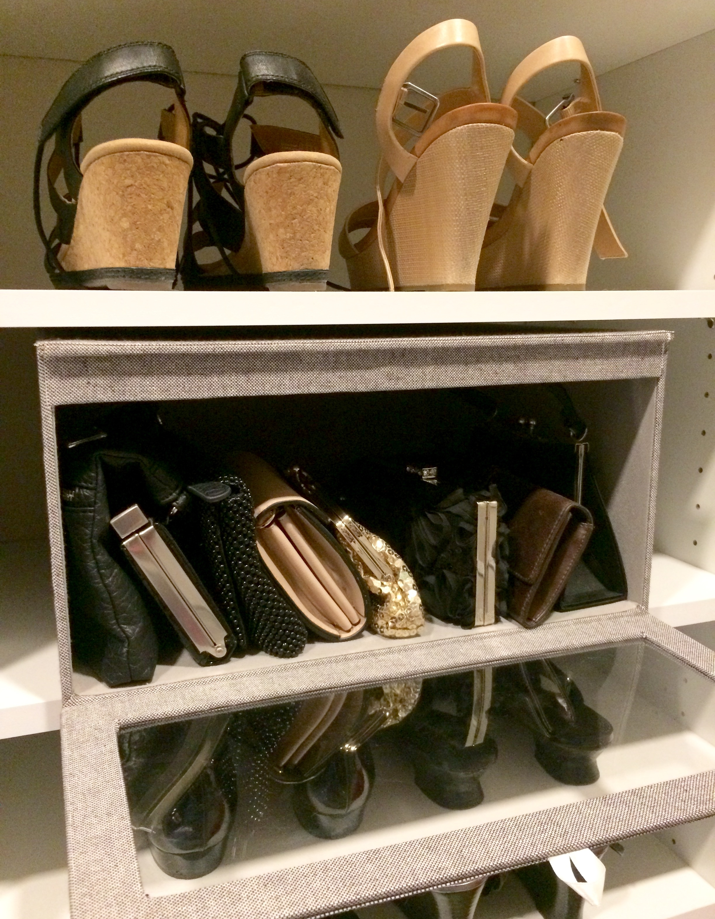 Transparent front-opening storage boxes are a beautiful way to store small handbags and other items that would otherwise be difficult to keep organized.  Call Closets of Tulsa  today for a FREE consultation and 3-D closet design:  918.609.0214