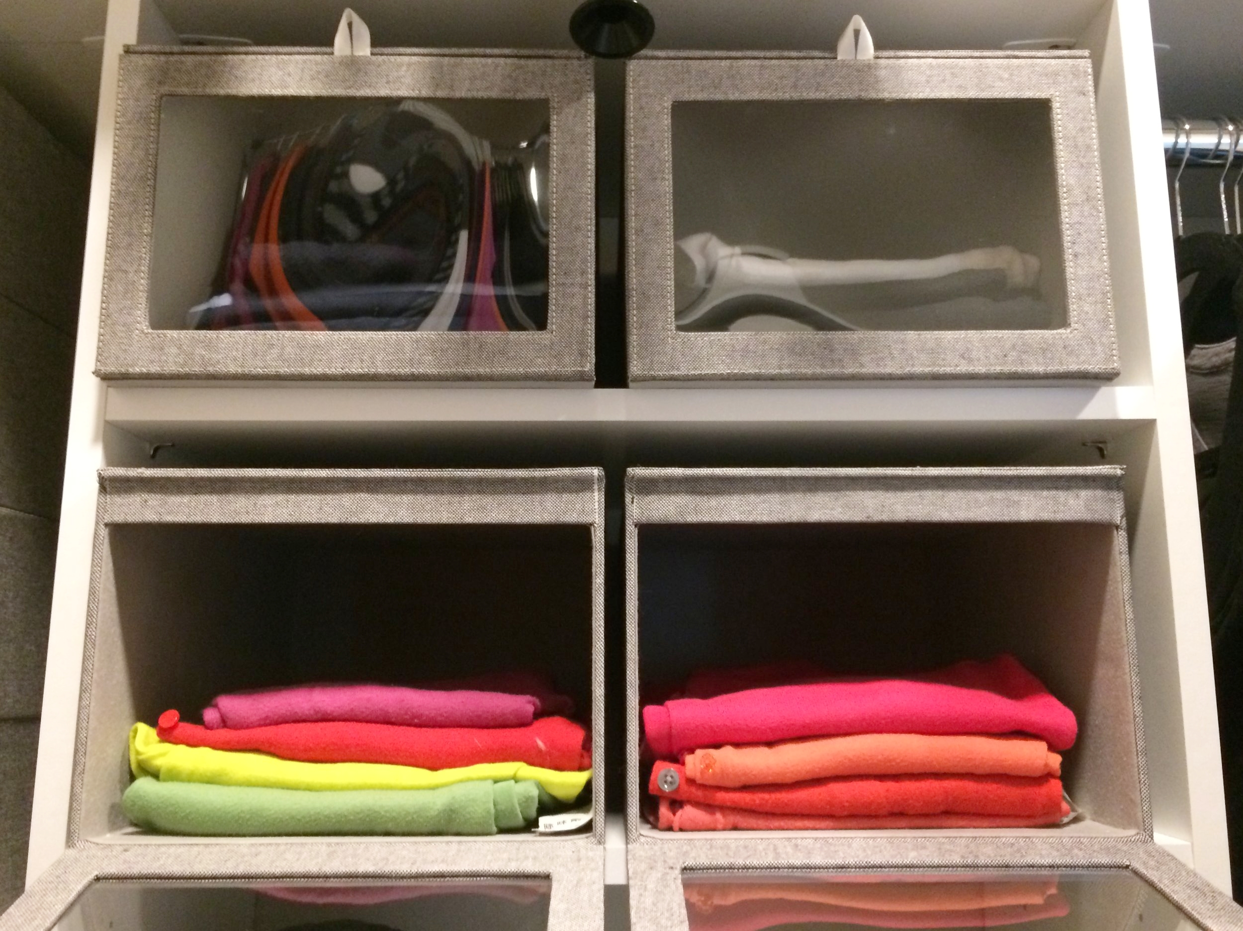 These closet storage boxes keep folded sweaters in tidy stacks.
