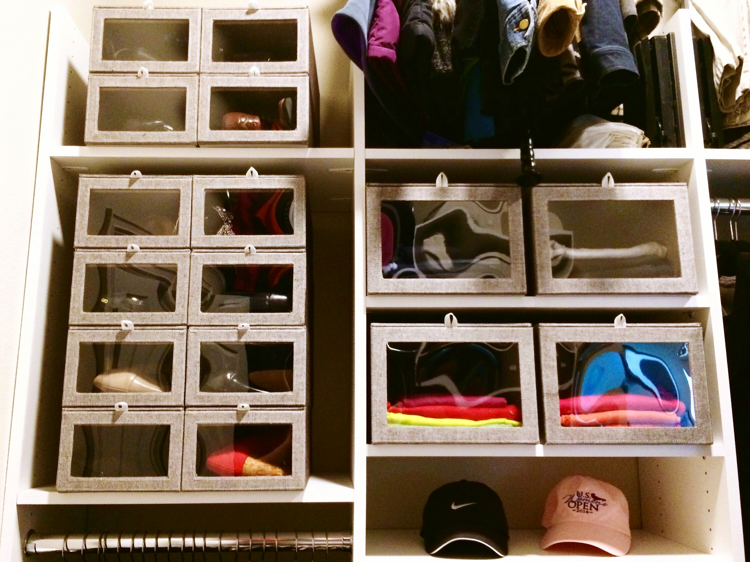 Storage boxes declutter your closet and serve many purposes: shoe organizer, purse display, off-season clothes storage.  Call Closets of Tulsa  today for a FREE consultation and 3-D closet design:  918.609.0214