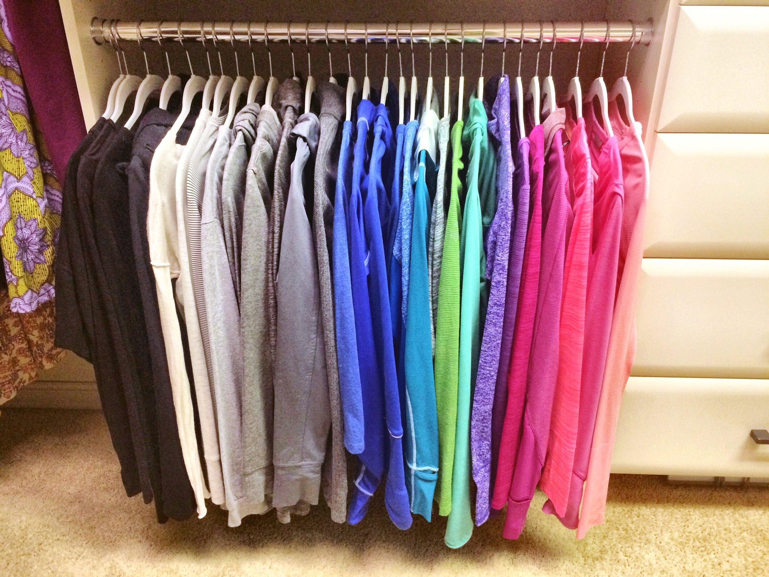 White felt hangers keep these athletic tops in place and looking tidy.  Call Closets of Tulsa  now for your FREE consultation and 3-D closet design:  918.609.0214