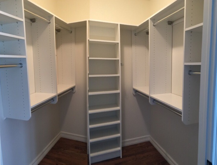 Fresh paint and crisp white closet shelving brighten up this smaller walk in closet.  Call Closets of Tulsa  today for a FREE consultation and 3-D closet design:  918.609.0214